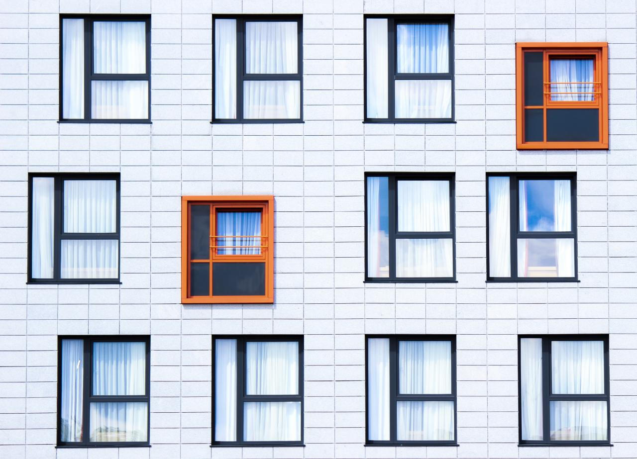 Several windows on the side of a building